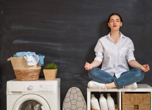 woman_meditating_in_her_laundry_room