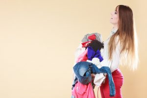 girl_in_red_pants_and_long_hair_carrying_laundry