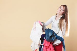 woman_with_long_hair_carrying_dirty_laundry