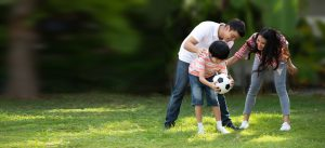 mother_father_son_playing_ball